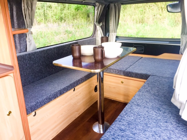 Nissan Nova campervan inside table with cups and plates